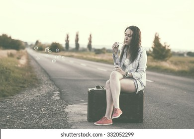 Vintage photo of traveler woman on the highway