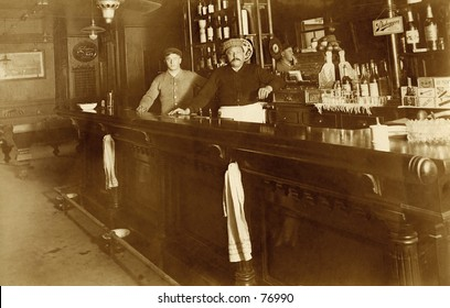 Vintage photo of two bartenders behind bar