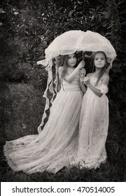 Vintage photo of two girls with umbrella