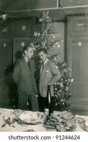 Vintage photo of two men at Christmas time (forties)