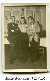 Vintage photo of two men and woman (forties)