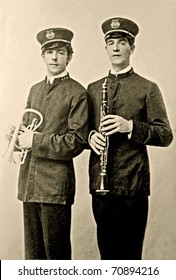 Vintage photo of two stately gentlemen who are in a band.