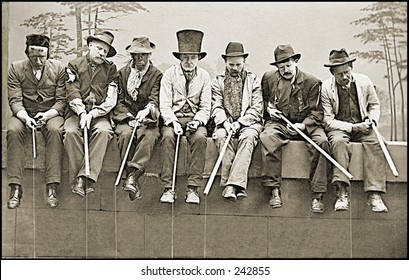 Vintage Photo of Vagabonds Sitting On Fence Wearing Hats