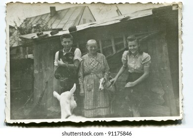 Vintage photo of villagers family with goats (forties)