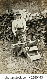 Vintage Photo of a woman sawing firewood