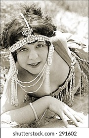 Vintage photo of a Woman Wearing Flapper Costume With Pearls