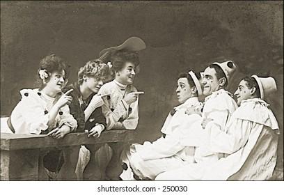 Vintage Photo of Women teasing Clowns
