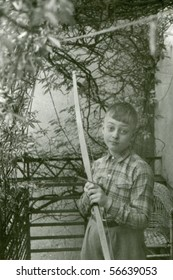Vintage photo of young boy with a bow