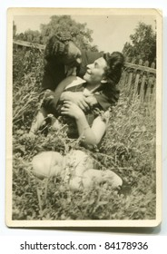 Vintage photo of young couple hugging outdoor (forties)