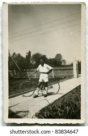 Vintage photo of young man with bike (forties)