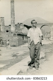 Vintage photo of young man visiting Pompeii (1957)