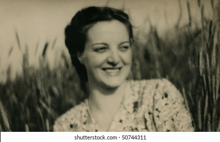 Vintage photo of young woman (1944)