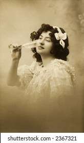 Vintage photo of a young woman drinking from a champaign glass