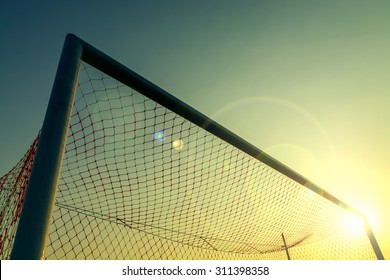 Vintage photography with soccer goal with lens flare effect