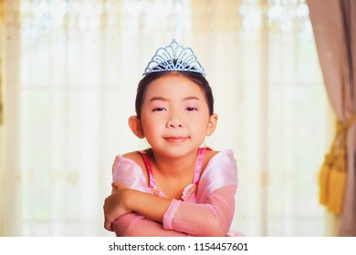 Vintage photography style of pretty Asian girl portrait in pink princess style costume, selected focus.