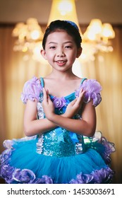 Vintage photography style of pretty Asian girl portrait in blue and purple ballet dancer style costume, selected focus.