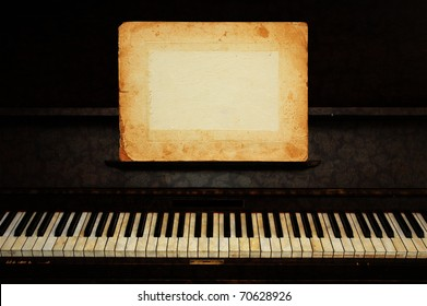 a vintage piano with empty paper