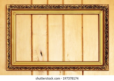 Vintage picture frame on a background of wooden planks.