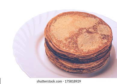 Vintage picture. Plate of pancakes with maple syrup topped on white background