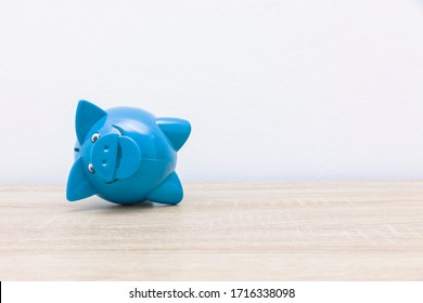 Vintage piggy bank on a wooden table
