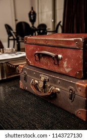 Vintage Pile Ancient Suitcases Form of Tower Design Concept Travel Luggage on a vintage living room
