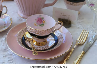 Vintage pink and black vintage tea cup, saucer, gold cutlery, polka dots high tea party