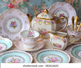 Vintage pink and blue tea cup set with roses