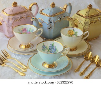vintage pink blue and yellow tea pots and tea cups