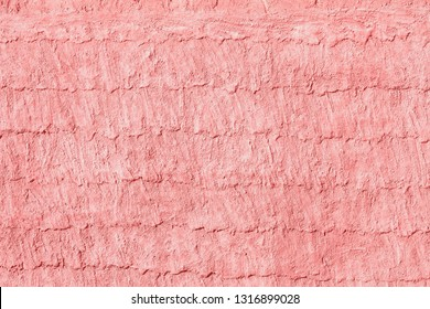 Vintage pink cement wall background and texture
