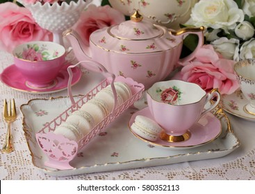 Vintage pink tea cup  and saucer with macaroons on a tray, and pink teapot - high tea party teacup