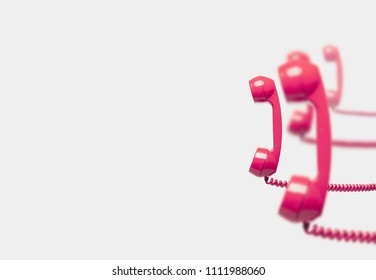 Vintage pink telephone reciver, Concepts of communication, busy office or telemarketing