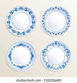 Vintage plates painted at gzhel style. pictures of russian dishes. Illustration of vintage gzhel plate floral