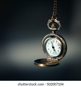 Vintage pocket watch on dark background, close up photo of old fashion watch.