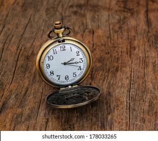 Vintage pocket watch  on wooden background