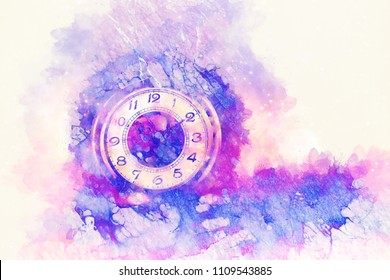 Vintage pocket watch and softly blurred watercolor background.