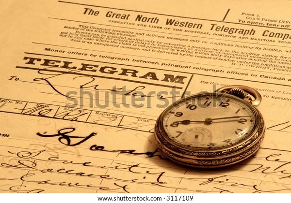 Vintage pocket-watch and old telegram notice.