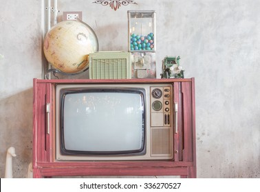 Vintage portable television and car model on top.Vintage style. public location