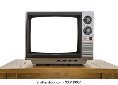 Vintage portable television and old wood table isolated on white with cut out screen.