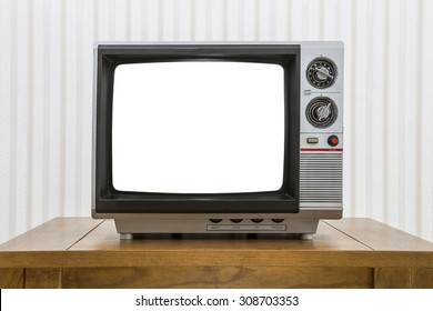 Vintage portable television on old craftsman style table with cut out screen and clipping path.