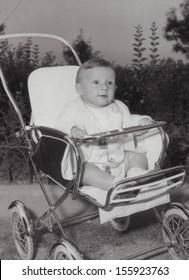 Vintage portrait of baby on the stroller