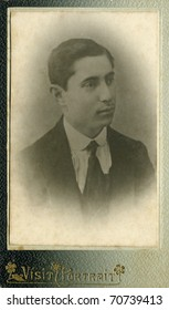 Vintage portrait of a young men. The shot was taken around 1914 year.