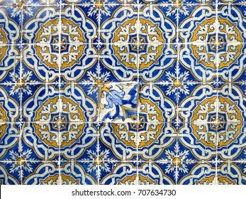 Vintage Portuguese tiles (azulejos) with a wrong mismatched tile in the middle