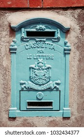 """Vintage post box with words """"Box for letters, Regie post"""" written on it in Capri island, Campania, Italy."""