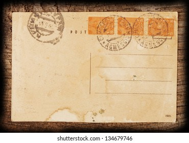 Vintage postcard on the rough wooden background