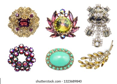 A lot of vintage precious brooch on a white isolated background