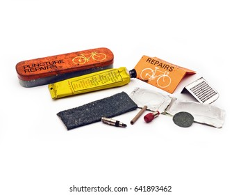 Vintage puncture repair kit;  vintage tin bike tire repair kit; isolated on white ground; good copy space