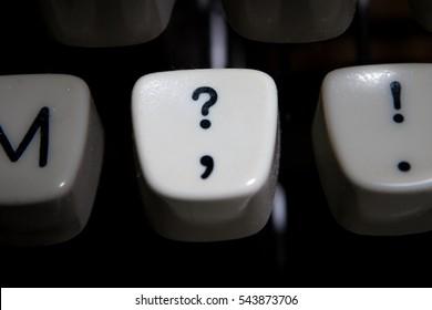 Vintage Question mark key highlighted on typewriter keyboard