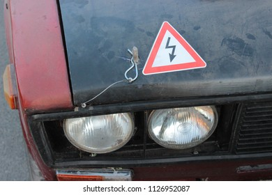 Vintage race car lights with warning sign