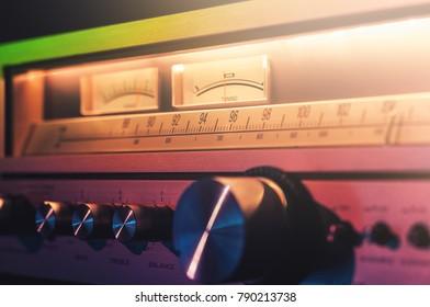 Vintage radio broadcast receiver amplifier shining in the dark