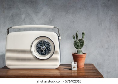 Vintage radio with cactus on the wooden table